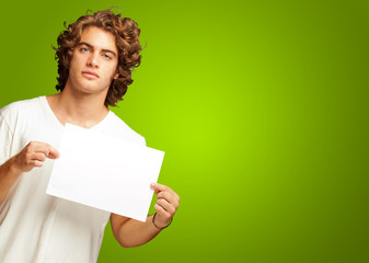Young Casual Man Holding A Blank Message