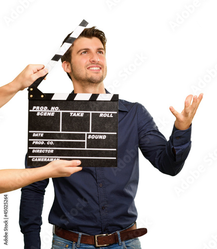 A Young Man Holding A Clapboard And Acting