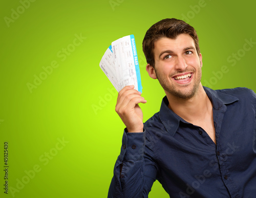 A Young Man Holding Tickets