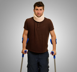 Portrait Of Young Man Walking On Crutches
