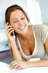 Cheerful young woman talking on the phone