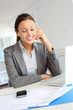 Smiling businesswoman sitting at her desk