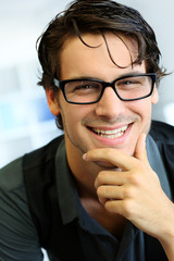 Portrait of handsome young man with glasses