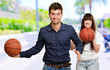 Man And Woman Holding Basketball