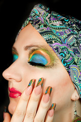 Beautiful Indian model makeup feathers in turban