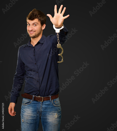 Young Man Wearing Handcuffs