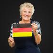 Senior Woman Holding Germany Flag