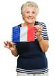 Senior Woman Holding France Flag