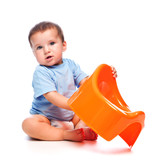 Little boy holding potty