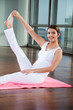 Happy Woman In Heron Pose At Gym