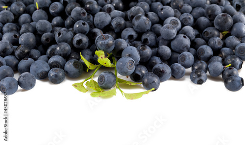 Blueberries with leaves on white  isolated background.