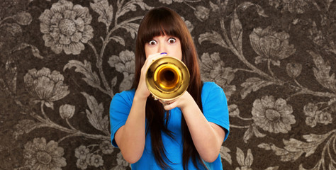 portrait of a teenager playing trumpet