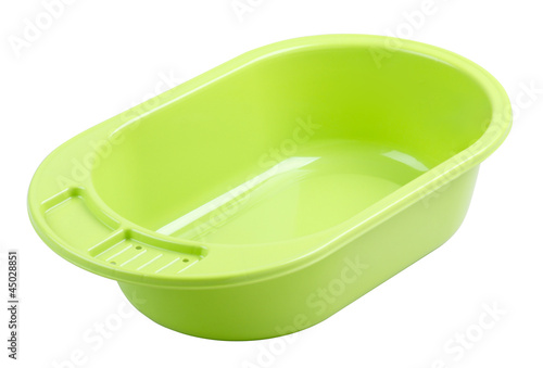 Empty baby's bathtub in green color isolated
