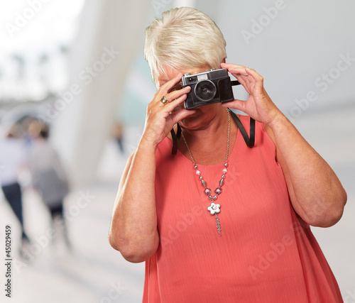 Senior Woman Clicking Photo