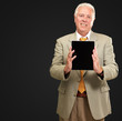 Senior Man Holding A Touchpad