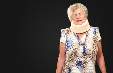 A Senior Woman Wearing A Neckbrace