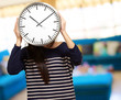 Young Girl Showing Clock And Hiding Her Face