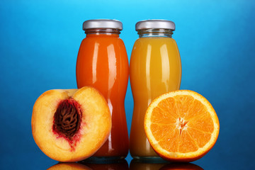 Delicious orange and peach juice in bottle and orange and peach