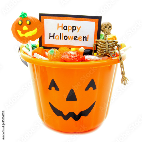 Halloween candy holder full of candy and Happy Halloween tag