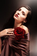 chocolate colored attractive woman with red rose