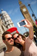 Tourists taking a picture in London