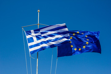 Greece and Europe flag on the wind