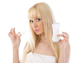 Beautiful woman holding cotton hygienic tampon
