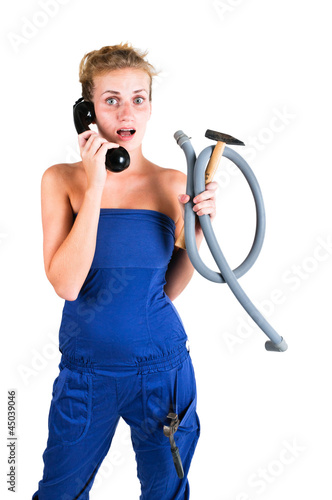 woman in overalls with tools calling for help