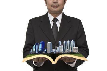 Business city  in businessman's hand