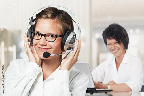 two women listening to you
