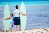 Father and son with surfboards