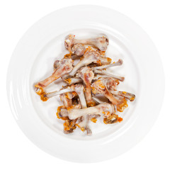 picked chicken bones on plate