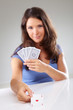 Woman with playing cards,  focus on ace of hearts
