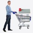 Mann mit Haus in Einkaufswagen