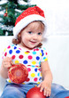 beautiful girl hold ornaments for the Christmas tree