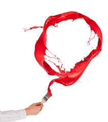 Woman hand painting red splashes circle on white background © Jag_cz