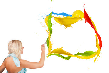 Beautiful paintress painting colored splashes frame