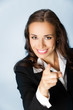 Business woman pointing finger at viewer