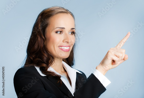 Businesswoman showing blank area