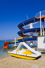 Waterslide and catamaran on beach