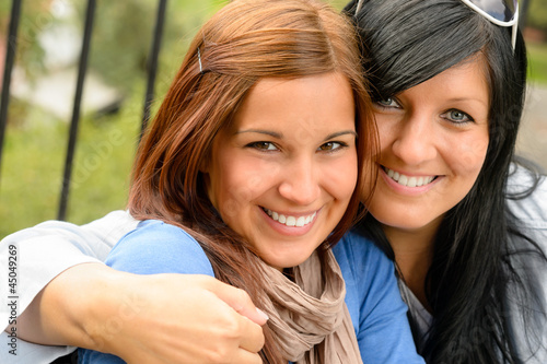 Mother and daughter in the park smiling
