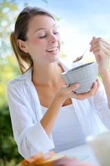 Beautiful woman having cereals for breakfast