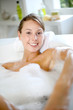 Cheerful young woman enjoying bath time