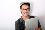 Closeup of smiling funky guy using tablet