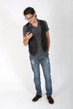 Cool guy on white background with smartphone