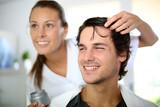 Hairdresser applying hair gel