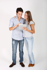 Young couple doing shopping on internet