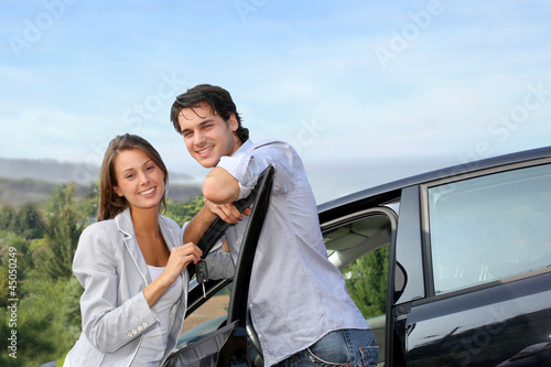 Young couple on a week-end trip in car