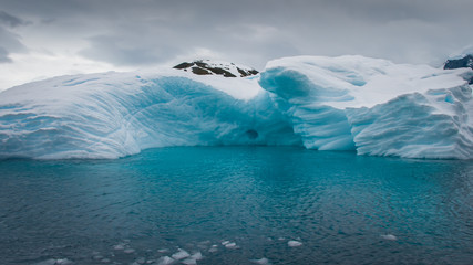 Iceberg drifting in the aquamarine sea of Antarctica