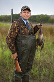 man with gun after hunting bring a duck poster